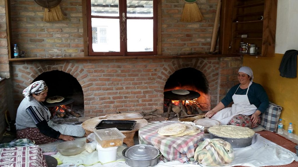 Women making gozleme (Turkish flatbread) at a restaurant called Koy Sofrasi in Kirazli Village.